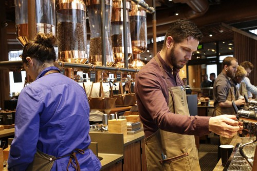 Starbucks baristas prepare drinks during a preview of its new Reserve Roastery and Tasting Room in Seattle