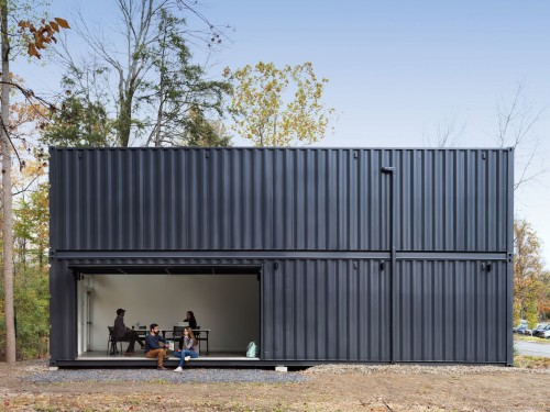 the-main-room-opens-to-the-quad-through-a-large-pivoting-garage-door